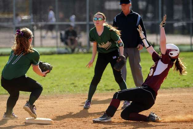 Colonie's Stephanie Reinhardt is out on the force by Shen's Courtney McDunn during their high school girl's softball game on Wednesday April 17, 2013 in Colonie, N.Y. (Michael P. Farrell/Times Union) Photo: Michael P. Farrell