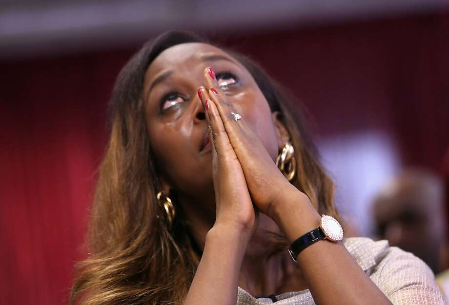 NEW YORK, NY - APRIL 17:  Rwandan immigrant and genocide survivor Immaculee Ilibagiza looks up after taking the oath of American citizenship at a naturalization ceremony on April 17, 2013 in New York City. Fifty immigrants from 15 countries became American citizens at the ceremony held by the U.S. Citizenship and Immigration Services (USCIS). Ilibagiza originally came to the U.S. as a political asylee after spending three months in hiding during the Rwandan genocide in 1994.  (Photo by John Moore/Getty Images) Photo: John Moore, Getty Images