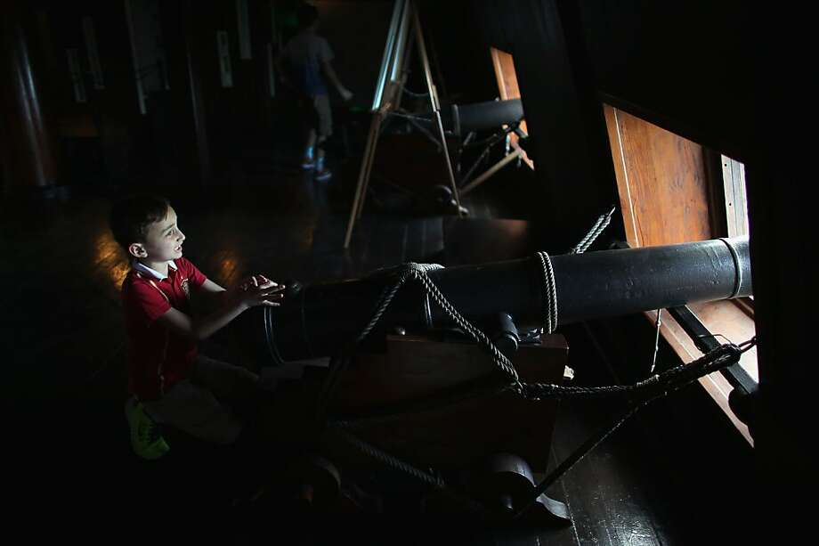 MIAMI, FL - APRIL 17:  Alex Tabares checks out one of the canons aboard El Galeón, a replica of a 16th century galleon, during Florida's commemoration of the 500th anniversary of Spanish explorer Juan Ponce de Leon's arrival on the shores of Florida on April 17, 2013 in Miami, Florida. The boat will remain in Miami until April 28, after which it continues North along Florida's east coast and stops along the way in Fort Lauderdale, Cape Canaveral,  and St. Augustine.  (Photo by Joe Raedle/Getty Images) Photo: Joe Raedle, Getty Images