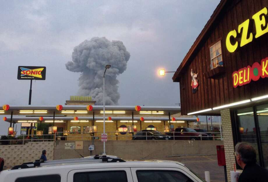 People at the Czech Stop look at a cloud of smoke rising from an explosion at a fertilizer plant in West, Texas Wednesday, April 17, 2013. (Photo courtesy Andy Bartee via Dallas Morning News/MCT) Photo: Andy Bartee, McClatchy-Tribune News Service / Dallas Morning News