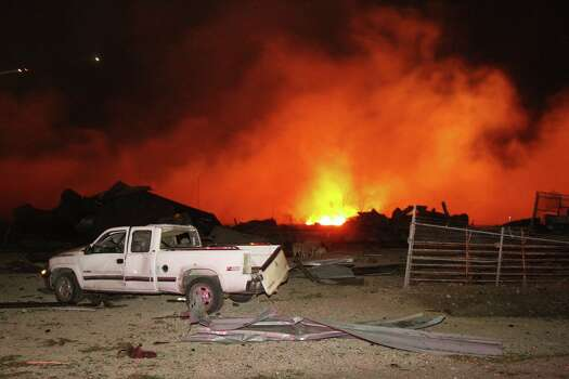 A fire burns at a fertilizer plant in West, Texas after an explosion Wednesday April 17, 2013. (APMichael Ainsworth/The Dallas Morning News) Photo: Michael Ainsworth, Associated Press / Dallas Morning News