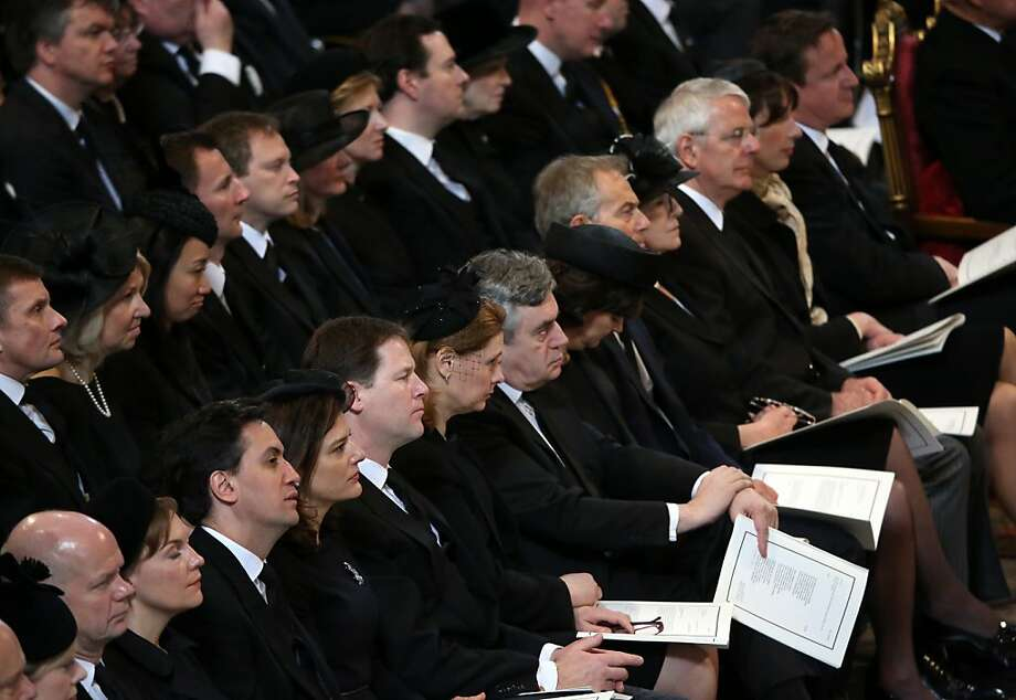 (Front Row) British Foreign Secretary William Hague, Leader of the Labour Party Ed Miliband, Deputy Prime Minister Nick Clegg, Sarah Brown, former prime minister Gordon Brown, Cherie Blair, former prime minister Tony Blair, Norma Major, former prime minister John Major, Samantha Cameron and Prime Minister David Cameron attend the ceremonial funeral of British former prime minister Margaret Thatcher at St Paul's Cathedral in central London on April 17, 2013. The funeral of Margaret Thatcher took place on April 17, with Queen Elizabeth II leading mourners from around the world in bidding farewell to one of Britain's most influential and divisive prime ministers.  AFP PHOTO / POOL / CHRISTOPHER FURLONGChristopher Furlong,Christopher Furlong/AFP/Getty Images Photo: Afp, AFP/Getty Images