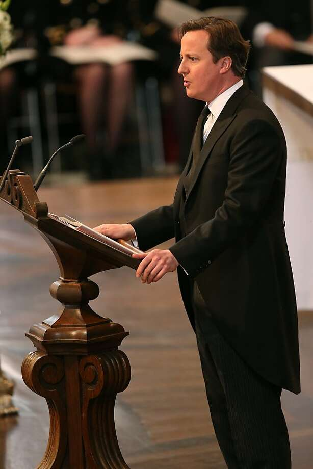 British Prime Minister David Cameron gives a reading during the ceremonial funeral of British former prime minister Margaret Thatcher at St Paul's Cathedral in central London on April 17, 2013. The funeral of Margaret Thatcher took place on April 17, with Queen Elizabeth II leading mourners from around the world in bidding farewell to one of Britain's most influential and divisive prime ministers.  AFP PHOTO / POOL / CHRISTOPHER FURLONGChristopher Furlong,Christopher Furlong/AFP/Getty Images Photo: Afp, AFP/Getty Images