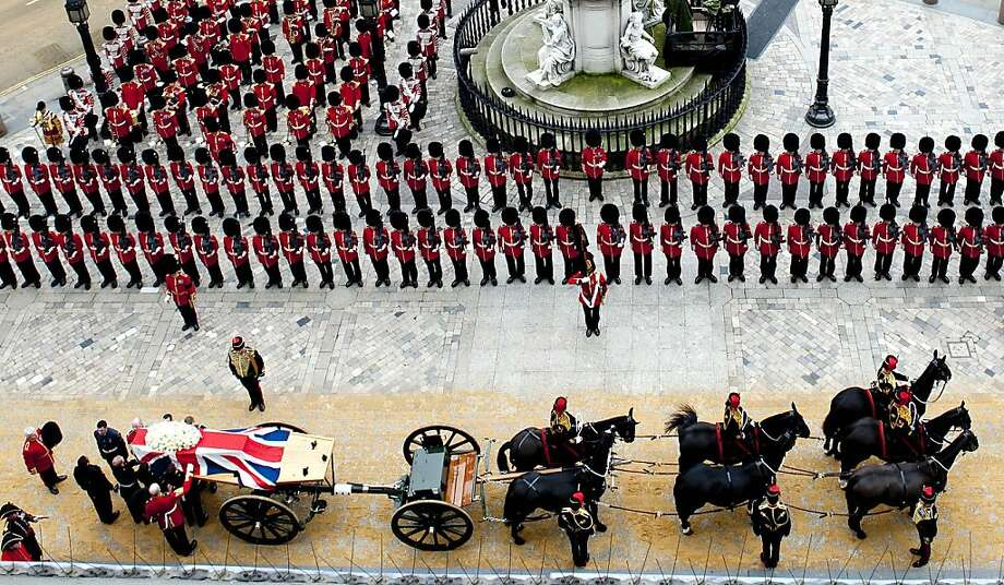 LONDON, ENGLAND - APRIL 17: The funeral cortege carrying the coffin of former British Prime Minister Margaret Thatcher arrives at St Paul's Cathedral on April 17, 2013 in London, England. Dignitaries from around the world today join Queen Elizabeth II and Prince Philip, Duke of Edinburgh as the United Kingdom pays tribute to former Prime Minister Baroness Thatcher during a Ceremonial funeral with military honours at St Paul's Cathedral. Lady Thatcher, who died last week, was the first British female Prime Minister and served from 1979 to 1990. (Photo by David Crump - WPA Pool/Getty Images) Photo: WPA Pool, Getty Images
