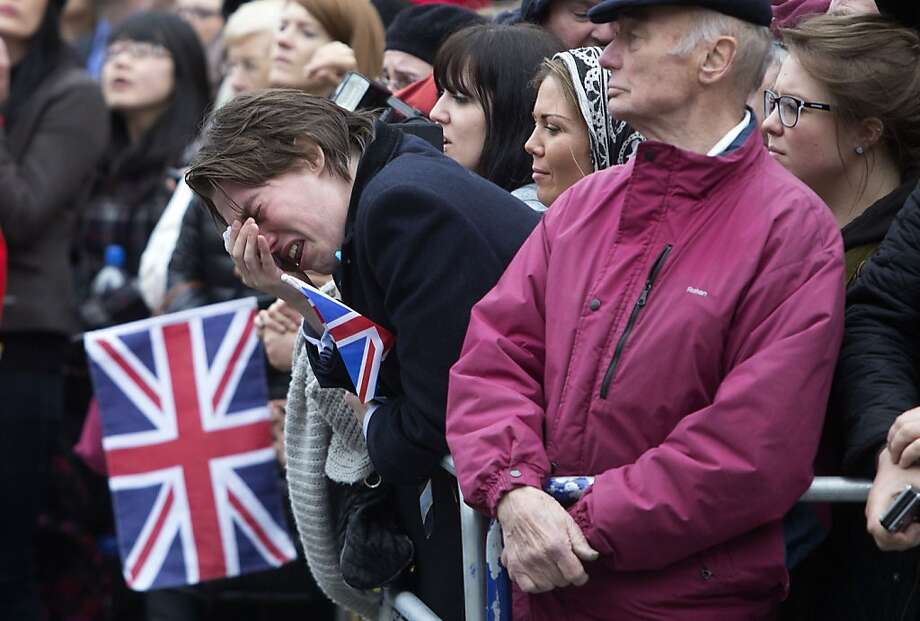 LONDON, UNITED KINGDOM - APRIL 17:  A member of the public weeps as the coffin of Baroness Thatcher is carried out of St Clement Danes church for the start of her state funeral procession through the City of London to St Pauls Cathedral on April 17, 2013 in London, England. Dignitaries from around the world today join Queen Elizabeth II and Prince Philip, Duke of Edinburgh as the United Kingdom pays tribute to former Prime Minister Baroness Thatcher during a Ceremonial funeral with military honours at St Paul's Cathedral. Lady Thatcher, who died last week, was the first British female Prime Minister and served from 1979 to 1990. (Photo by Richard Pohle - WPA Pool/Getty Images) Photo: WPA Pool, Getty Images