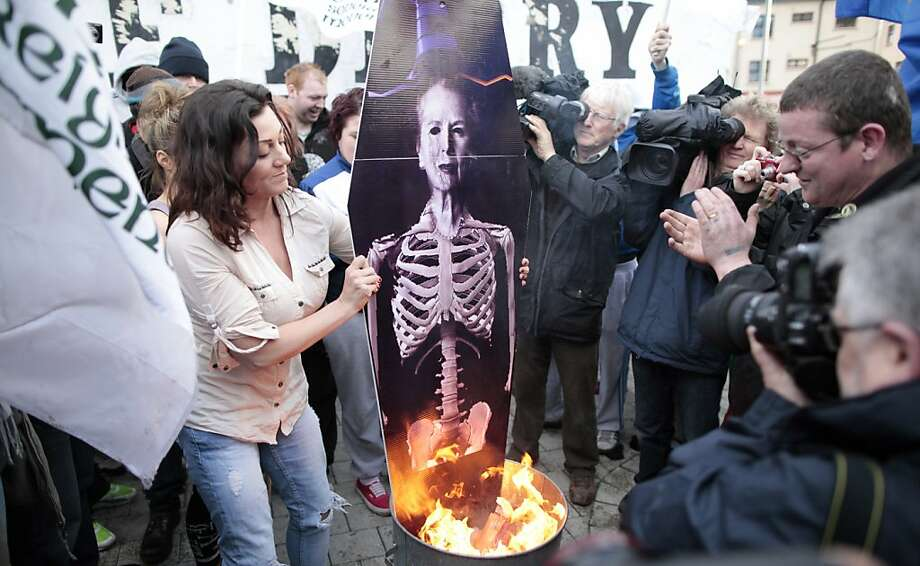 Irish Republicans are watched by the media as they burn a mock coffin of Margaret Thatcher in the Bogside area of Londonderry, Northern Ireland, Wednesday, April 17, 2013, as anti Margaret Thatcher protesters mark the funeral of the former British Prime Minister.(AP Photo/Peter Morrison) Photo: Peter Morrison, Associated Press