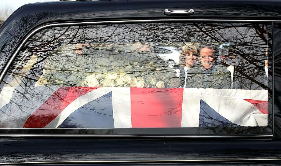 LONDON, ENGLAND - APRIL 17:  Former British Prime Minister Baroness Thatcher's coffin arrives in the hearse at Mortlake Crematorium where her private cremation will take place on April 17, 2013 in London, England. Dignitaries from around the world today join Queen Elizabeth II and Prince Philip, Duke of Edinburgh as the United Kingdom pays tribute to former Prime Minister Baroness Thatcher during a Ceremonial funeral with military honours at St Paul's Cathedral. Lady Thatcher, who died last week, was the first British female Prime Minister and served from 1979 to 1990.  (Photo by Danny E. Martindale/Getty Images) Photo: Danny E. Martindale, Getty Images