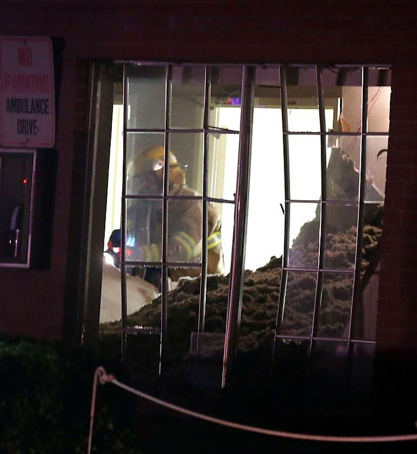 A fire fighter searches a nursing home that was damaged after an explosion at a neary by fertilizer plant Wednesday, April 17, 2013, in West, Texas. (AP Photo/ Waco Tribune Herald, Rod Aydelotte) Photo: Rod Aydelotte, Associated Press