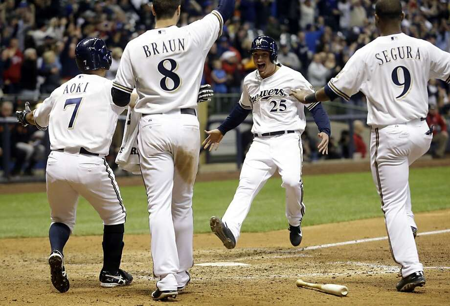 Milwaukee Brewers' Josh Prince (25) reacts as he scores the game-winning run during the ninth inning of a baseball game against the San Francisco Giants Wednesday, April 17, 2013, in Milwaukee. The Brewers won 4-3. (AP Photo/Morry Gash) Photo: Morry Gash, Associated Press