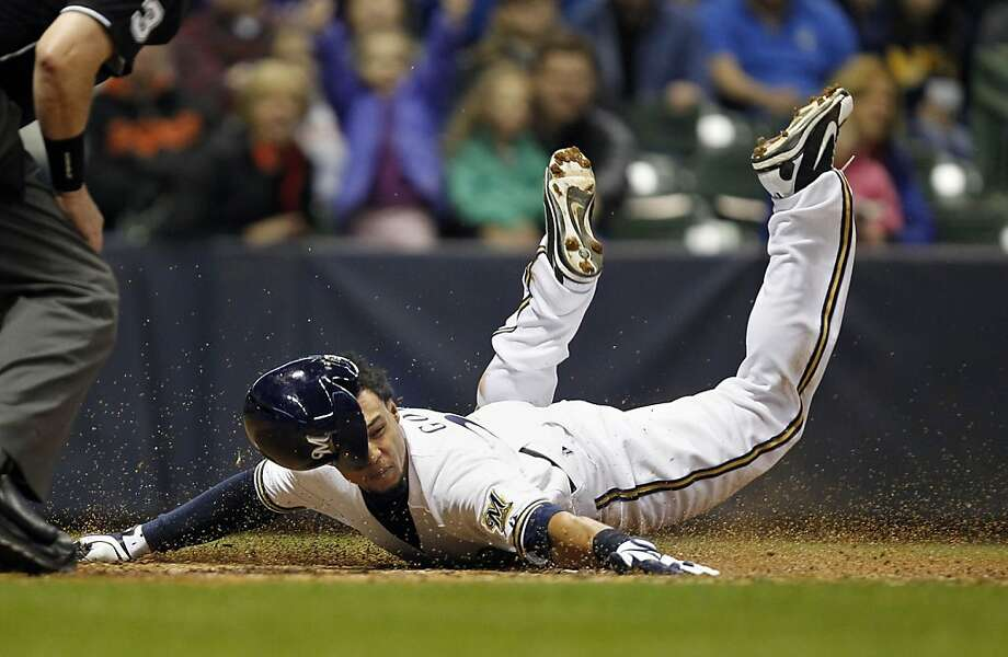 Milwaukee Brewers Carlos Gomez (27) scores in the 5th against the San Francisco Giants at Miller Park in Milwaukee, Wisconsin, Wednesday, April 17, 2013. (Rick Wood/Milwaukee Journal Sentinel/MCT) Photo: Rick Wood, McClatchy-Tribune News Service
