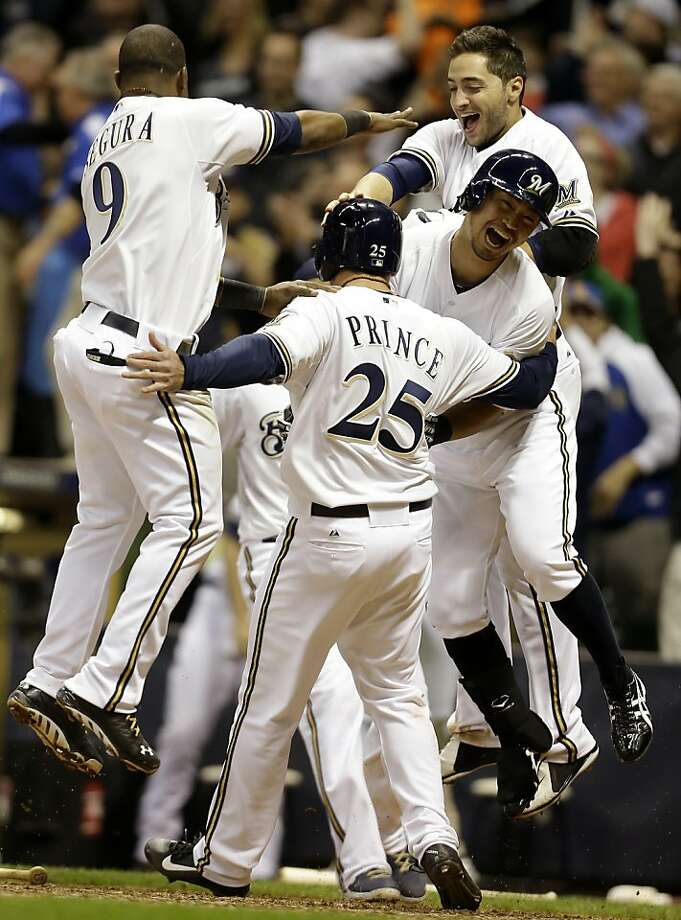 MILWAUKEE, WI - APRIL 17: Josh Prince #25 of the Milwaukee Brewers celebrates Jean Segura #9, Norichika Aoki #7 and Ryan Braun #8 after Blake Lalli singles scoring the scoring the winning run in the bottom of the ninth inning against the San Francisco Giants at Miller Park on April 17, 2013 in Milwaukee, Wisconsin. (Photo by Mike McGinnis/Getty Images) Photo: Mike McGinnis, Getty Images