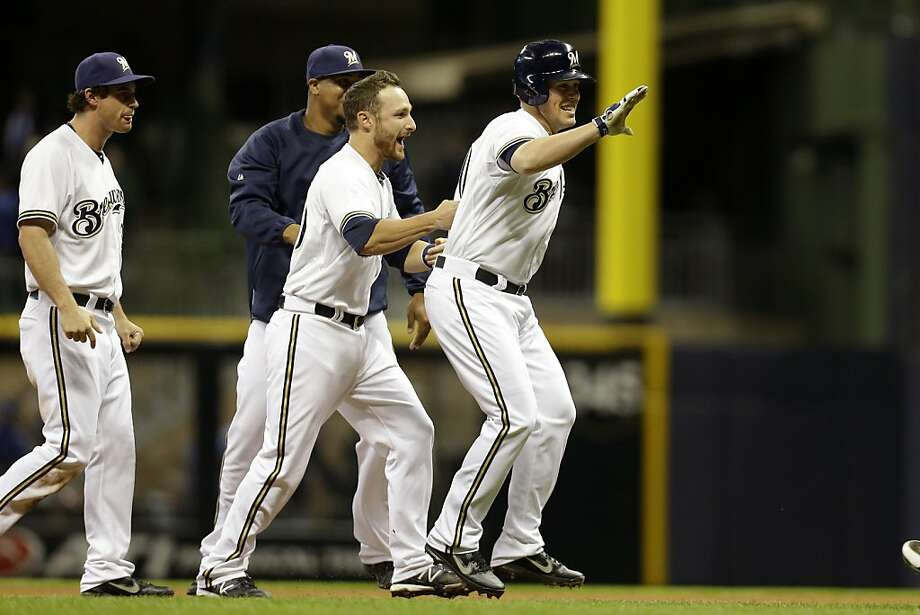 MILWAUKEE, WI - APRIL 17: Blake Lalli #50 of the Milwaukee Brewers celebrates with Jonathan Lucroy after hitting a game winning single in the bottom of the ninth inning against the San Francisco Giants at Miller Park on April 17, 2013 in Milwaukee, Wisconsin. (Photo by Mike McGinnis/Getty Images) Photo: Mike McGinnis, Getty Images