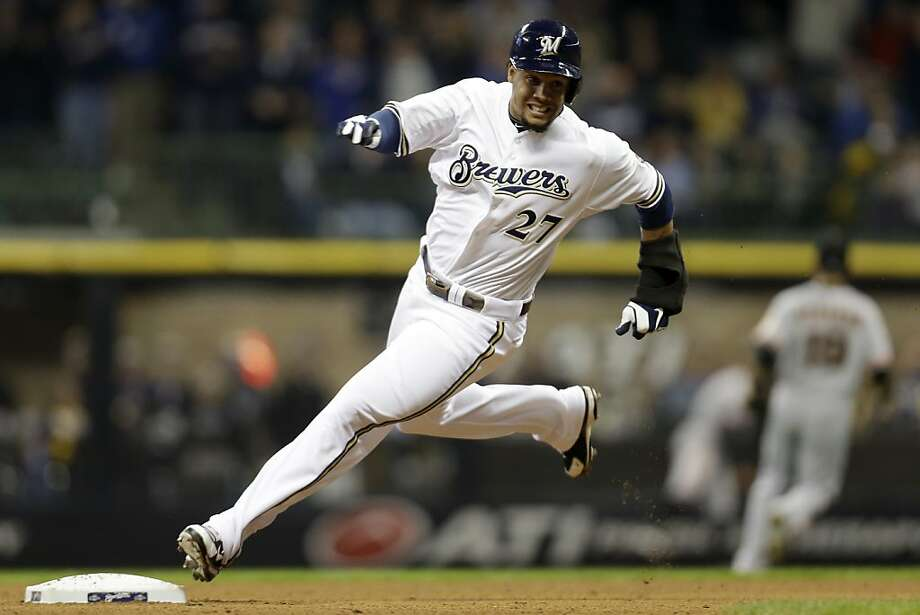 MILWAUKEE, WI - APRIL 17: Carlos Gomez #27 of the Milwaukee Brewers rounds second base on a triple scoring Alex Gonzalez in the bottom of the fifth inning against the San Francisco Giants at Miller Park on April 17, 2013 in Milwaukee, Wisconsin. (Photo by Mike McGinnis/Getty Images) Photo: Mike McGinnis, Getty Images