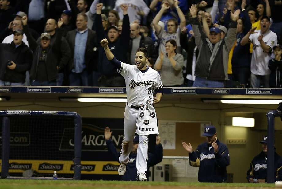 MILWAUKEE, WI - APRIL 17: Ryan Braun #8 of the Milwaukee Brewers runs onto the field after Blake Lalli singles scoring the scoring the winning run in the bottom of the ninth inning against the San Francisco Giants at Miller Park on April 17, 2013 in Milwaukee, Wisconsin. (Photo by Mike McGinnis/Getty Images) Photo: Mike McGinnis, Getty Images