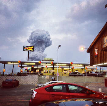 In this Instagram photo provided by Andy Bartee, a plume of smoke rises from a fertilizer plant fire in West, Texas on Wednesday, April 17, 2013.  An explosion at a fertilizer plant near Waco Wednesday night injured dozens of people and sent flames shooting high into the night sky, leaving the factory a smoldering ruin and causing major damage to surrounding buildings. (AP Photo/Andy Bartee) MANDATORY CREDIT: ANDY BARTEE Photo: Andy Bartee, Associated Press / Andy Bartee