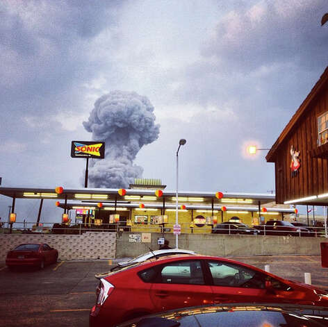 In this Instagram photo provided by Andy Bartee, a plume of smoke rises from a fertilizer plant fire in West, Texas on Wednesday, April 17, 2013.  An explosion at a fertilizer plant near Waco Wednesday night injured dozens of people