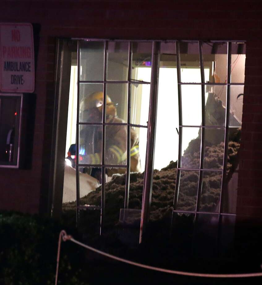 A fire fighter searches a nursing home that was damaged after an explosion at a neary by fertilizer plant Wednesday, April 17, 2013, in West, Texas. (AP Photo/ Waco Tribune Herald, Rod Aydelotte) Photo: Rod Aydelotte, Associated Press / Waco Tribune Herald