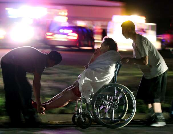 An injured elderly person is assisted by two young males as a nursing home is evacuated after an explosion at a nearby fertilizer plant Wednesday, April 17, 2013, in West, Texas. (AP Photo/Waco Tribune Herald, Rod Aydelotte) Photo: Rod Aydelotte, Associated Press / Waco Tribune Herald
