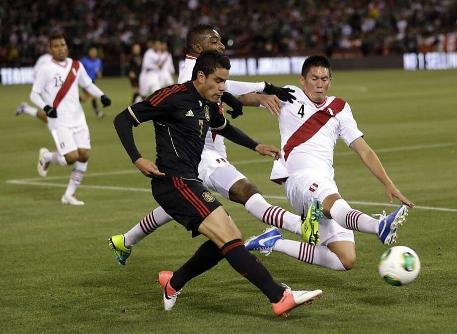 Mexico's Pablo Barrera (7) attempts a cross as Peru's Orlando Contreras (4) defends during the first half of an international friendly soccer match on Wednesday, April 17, 2013, in San Francisco. (AP Photo/Marcio Jose Sanchez) Photo: Marcio Jose Sanchez, Associated Press