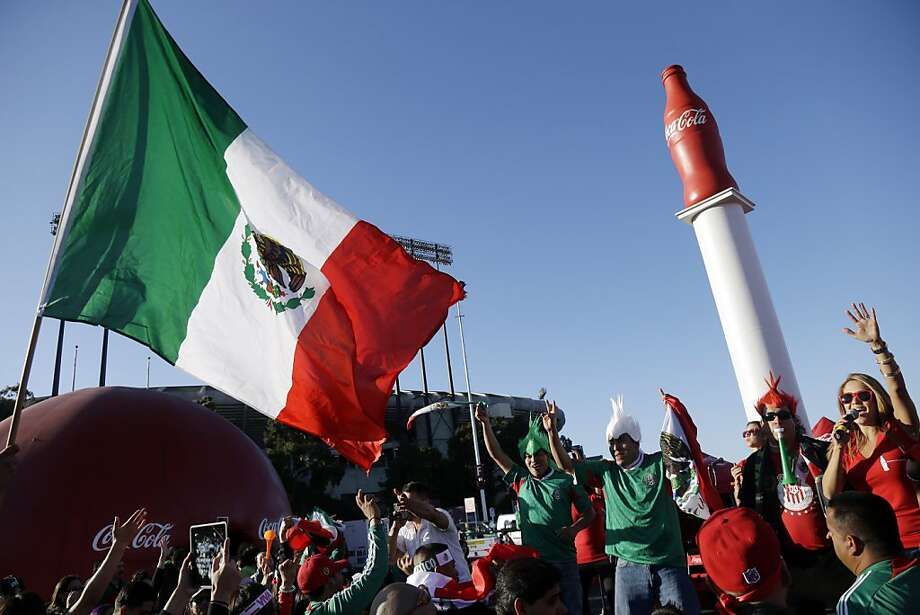Mexico fans celebrate on a stage before an international friendly soccer match against Peru, Wednesday, April 17, 2013, in San Francisco. (AP Photo/Marcio Jose Sanchez) Photo: Marcio Jose Sanchez, Associated Press