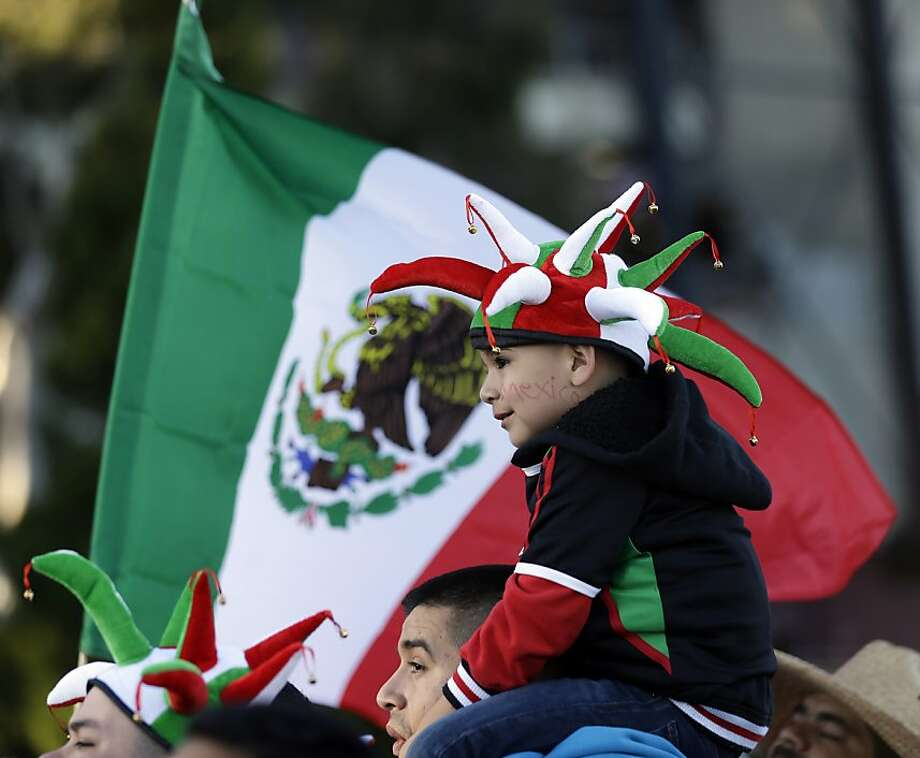 Mexico fan Kevin Ramirez, 4, of Turlock, Calif., waits for the team bus to arrive before an international friendly soccer match against Peru, Wednesday, April 17, 2013, in San Francisco. (AP Photo/Marcio Jose Sanchez) Photo: Marcio Jose Sanchez, Associated Press