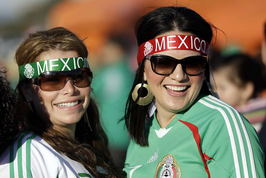 Mexico fans smile before an international friendly soccer match against Peru, Wednesday, April 17, 2013, in San Francisco. (AP Photo/Marcio Jose Sanchez) Photo: Marcio Jose Sanchez, Associated Press