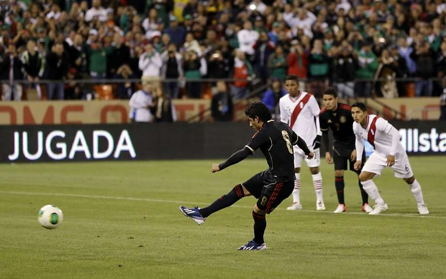 Mexico's Angel Reyna (8) misses on a penalty shot against Peru during the second half of an international friendly soccer match on Wednesday, April 17, 2013, in San Francisco. The match ended in a 0-0 tie.(AP Photo/Marcio Jose Sanchez) Photo: Marcio Jose Sanchez, Associated Press