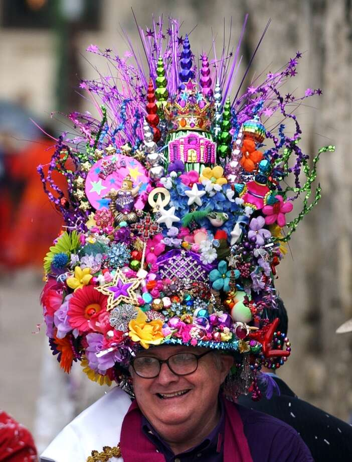 Unofficial royalty: Allow me to spend more words on Fiesta's true aristocracy: unofficial royalty. You need only be outrageous like Cal Sumner, the self-proclaimed Fiesta Hat King, or the Fiesta Hat Queens. These are the real rock stars who can hardly navigate a crowd because they're always taking pictures with groupies. The hardcore unofficial royalty make their own medals to distribute to their subjects.