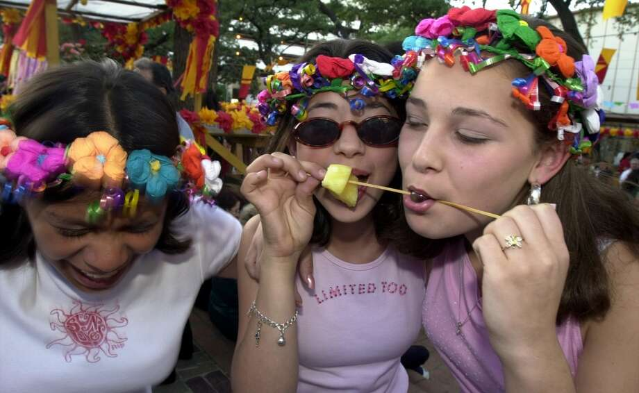 Fashion — flower wreathes or whatever they're called:Flower halos? Head wreathes? Fiesta coronets? Whatever you call them, they are everywhere, and they are a must accessory for ladies during Fiesta.