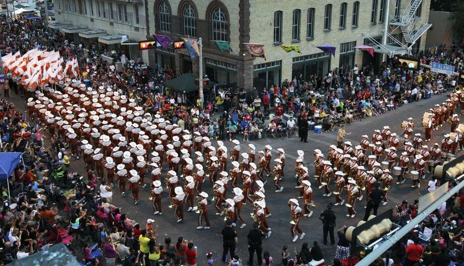 Fiesta Flambeau Night Parade:If the day parade is more of a formal affair, the night parade is when San Antonio really lets loose. The University of Texas Longhorn Band usually leads the parade, which shares the same route as the Battle of Flowers.