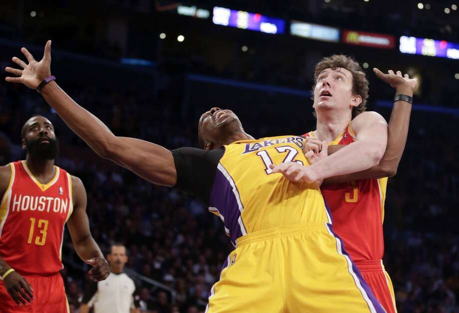 April 18: Lakers 99, Rockets 95  Rockets center Omer Asik and Lakers center Dwight Howard fight for position.