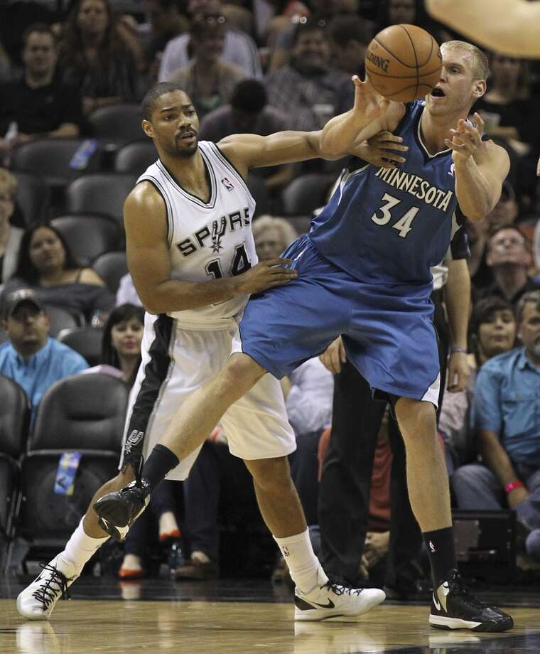 The Spurs\' Gary Neal (14) defends against the Minnesota Timberwolves\' Greg Stiemsma (34) in the first quarter at the AT&T Center on Wednesday, April 17, 2013.