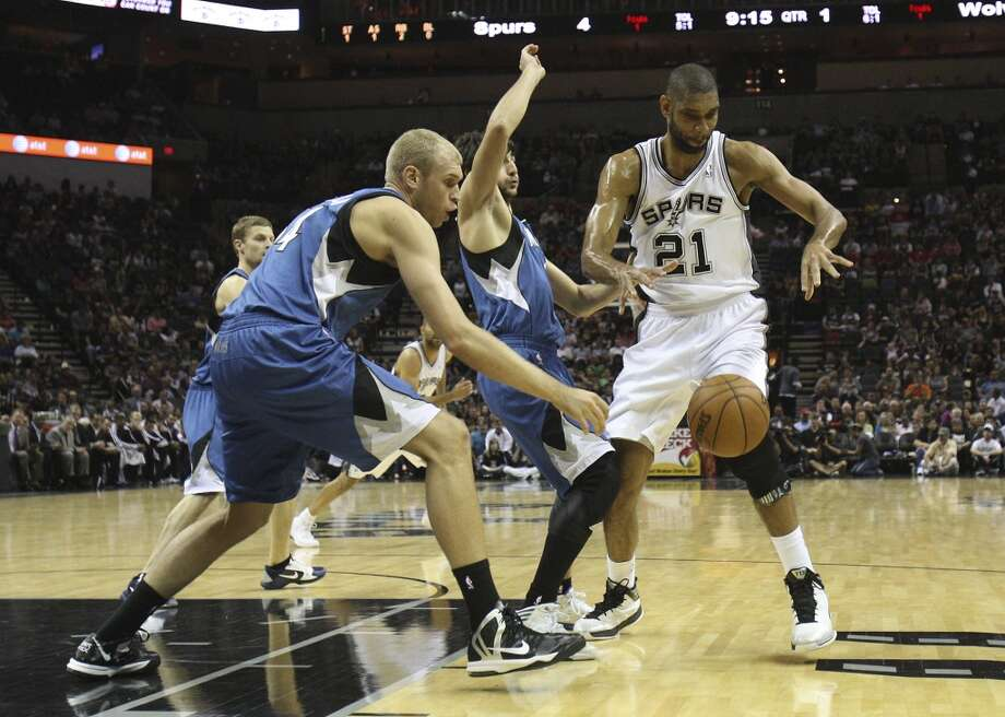 The Spurs\' Tim Duncan (21) looses the ball against the Minnesota Timberwolves\' Greg Stiemsma (34) and Ricky Rubio (09) in the first quarter at the AT&T Center on Wednesday, April 17, 2013.