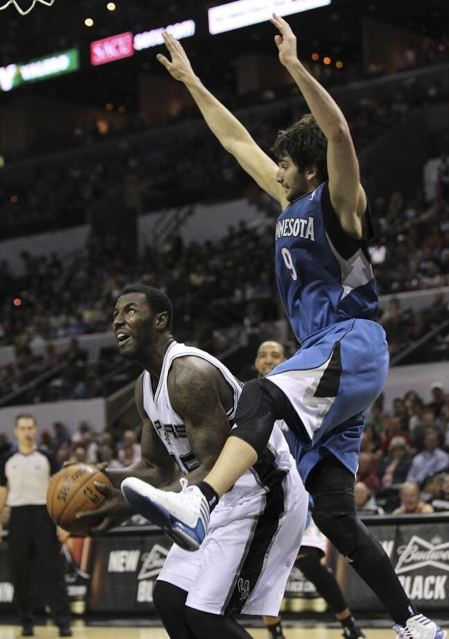 The Spurs\' DeJuan Blair (45) attempts a move on the Minnesota Timberwolves\' Ricky Rubio (09) in the second half at the AT&T Center on Wednesday, April 17, 2013. Timberwolves defeated the Spurs, 108-95.
