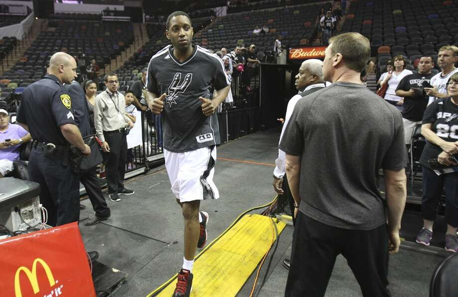 Tracy McGrady jogs out of the locker room to make his debut as a Spur during shoot-around prior to the start of the game against the Minnesota Timberwolves on Wednesday, April 17, 2013. McGrady was recently signed by the Spurs.