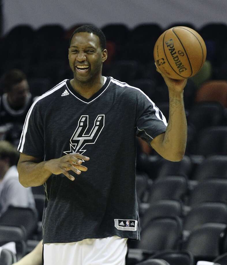 The Spurs\' Tracy McGrady laughs during shoot-around prior to the start of the game against the Minnesota Timberwolves on Wednesday, April 17, 2013. McGrady was recently signed by the Spurs.
