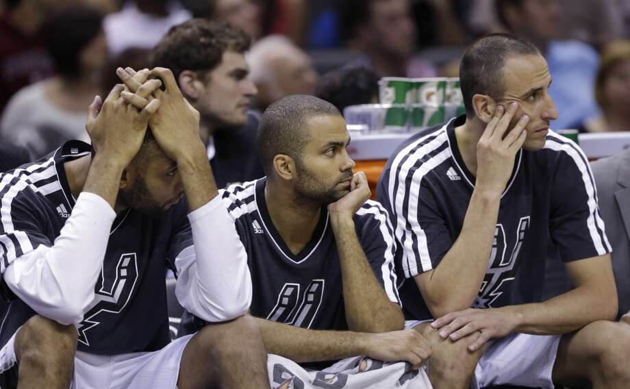 The Spurs\' Tim Duncan (from left), Tony Parker,  and Manu Ginobili sit on the bench during the second half against the Minnesota Timberwolves, Wednesday, April 17, 2013, at the AT&T Center. Minnesota won 108-95.