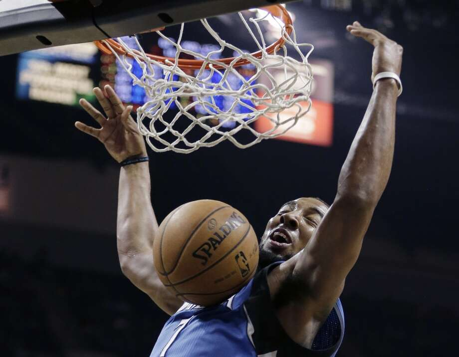 The Minnesota Timberwolves\' Derrick Williams dunks against the Spurs during the second half on Wednesday, April 17, 2013, at the AT&T Center. Minnesota won 108-95.