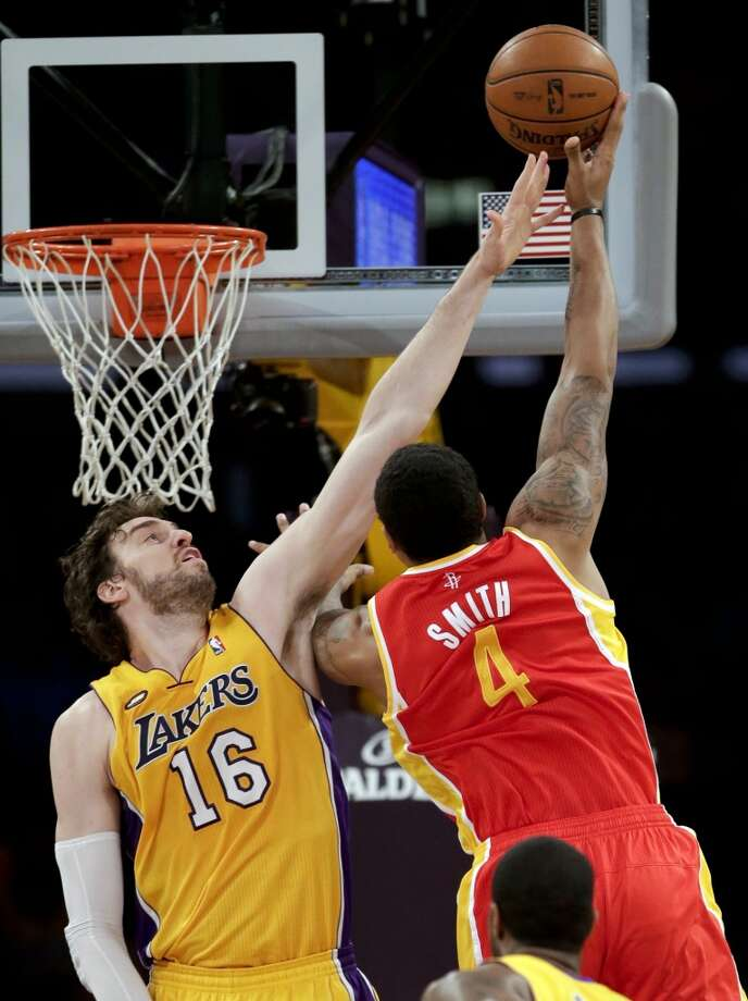 Rockets forward Greg Smith shoots over Pau Gasol of the Lakers.