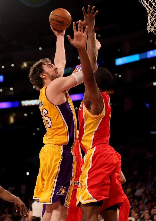 Pau Gasol of the Lakers shoots over Terrence Jones of the Rockets.