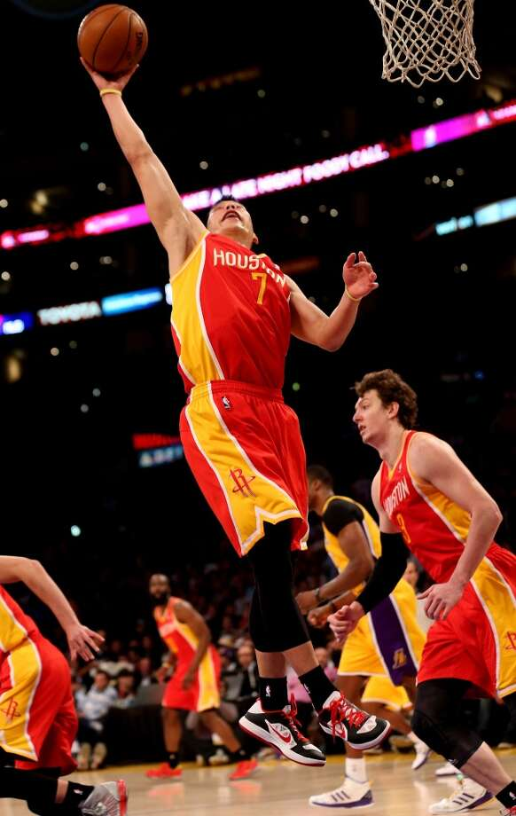 Rockets point guard Jeremy Lin grabs a rebound.