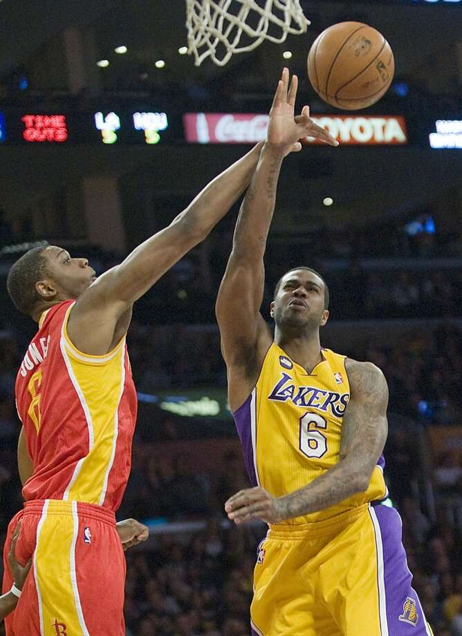 Terrence Jones of the Rockets blocks Lakers forward Earl Clark. Photo: Rose Palmisano, Orange County Register/MCT