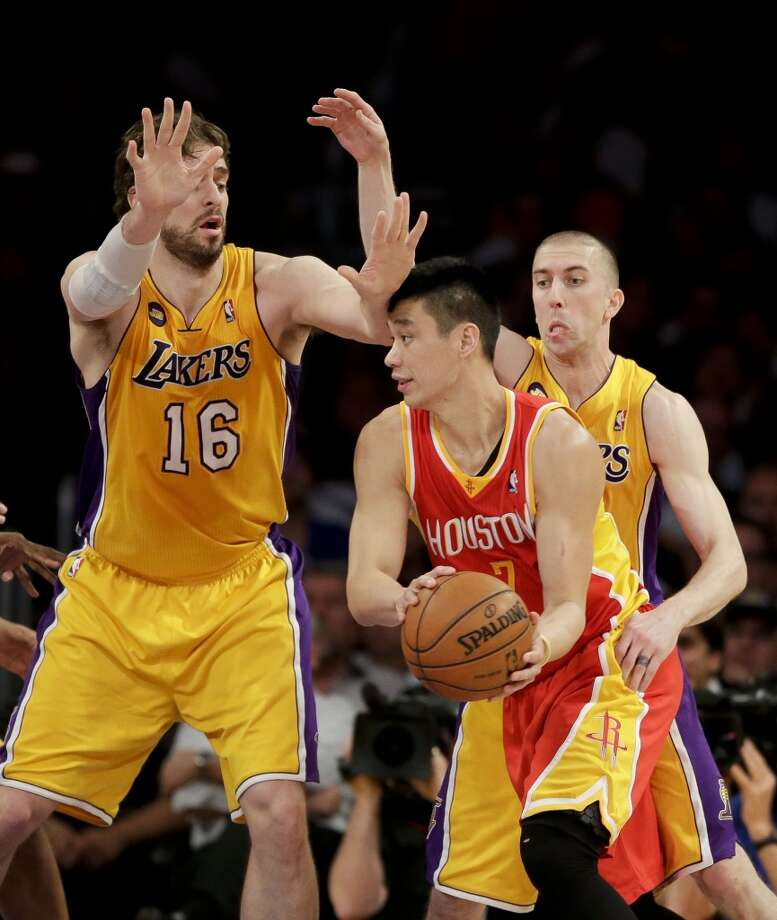 Jeremy Lin of the Rockets gets pressured by Lakers defenders Steve Blake and Pau Gasol. Photo: Jae C. Hong, Associated Press
