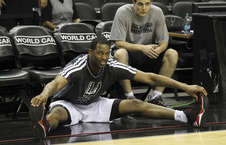The Spurs\' Tracy McGrady stretches out during shoot-around prior to the start of the game against the Minnesota Timberwolves on Wednesday, April 17, 2013. McGrady was recently signed by the Spurs.