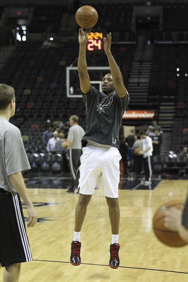 The Spurs\' Tracy McGrady takes a shot during shoot-around prior to the start of the game against the Minnesota Timberwolves on Wednesday, April 17, 2013. McGrady was recently signed by the Spurs.