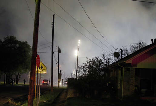 Smoke fills the air after a fertilizer plant explosion Wednesday, April 17, 2013, in West, Texas. A massive explosion at the fertilizer plant near Waco on Wednesday night injured dozens of people and sent flames shooting into the night sky, leaving the factory a smoldering ruin following a blast that damaged buildings for blocks in every direction. (AP Photo/Waco Tribune Herald, Rod Aydelotte) Photo: Rod Aydelotte, Associated Press / Waco Tribune Herald