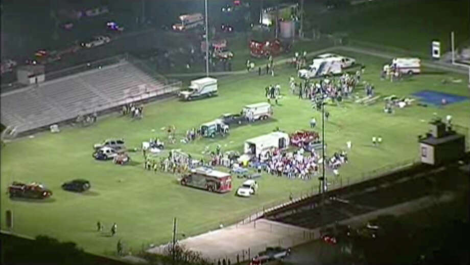 This video image provided by WFAA-TV shows injured people being treated on the flood-lit the high school football field turned into a staging area after the blast in West Texas Wednesday April 17, 2013. Photo: WFAA-TV