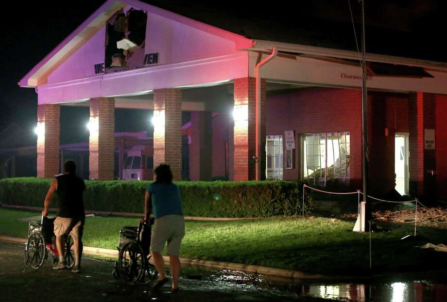 Persons are seen pushing wheel chairs in front of a damaged nursing home following an explosion at a nearby fertilizer plant Wednesday, April 17, 2013, in West, Texas. An explosion at a fertilizer plant near Waco caused numerous injuries and sent flames shooting high into the night sky on Wednesday. Photo: AP