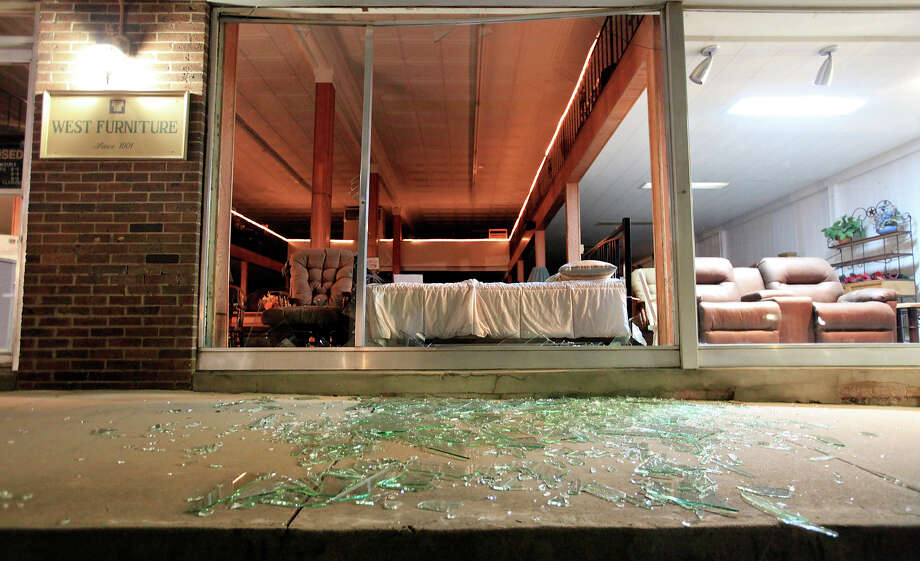 Shattered windows at West Furniture on Thursday morning, April 18, 2013, after an explosion Wednesday at a fertilizer plant in West. Photo: Edward A. Ornelas, San Antonio Express-News / © 2013 San Antonio Express-News