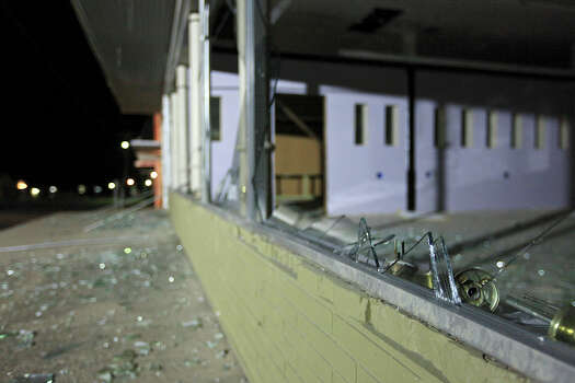 Shattered windows on Thursday morning, April 18, 2013, after an explosion Wednesday night at a fertilizer plant in West. Photo: Edward A. Ornelas, San Antonio Express-News / © 2013 San Antonio Express-News